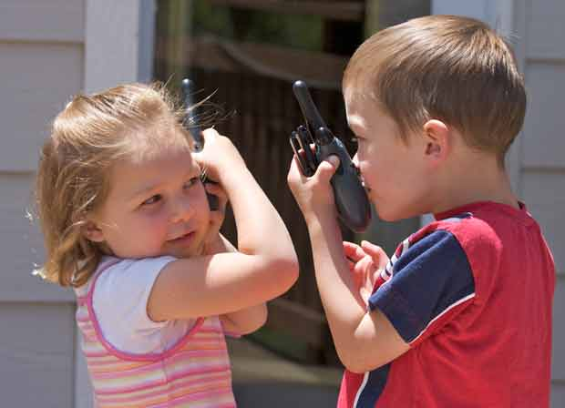 Kids talking on walkie-talkies